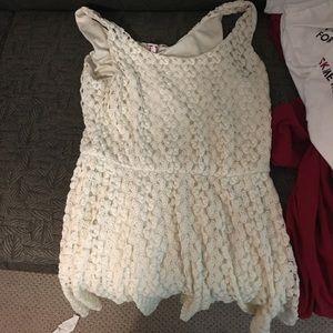 Lacy white sleeveless dress